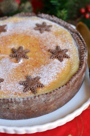 decorare la cheesecake con delle stelline di frolla al cacao e dello zucchero a velo